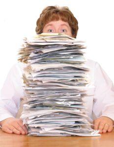 female-doctor-pile-of-paperwork