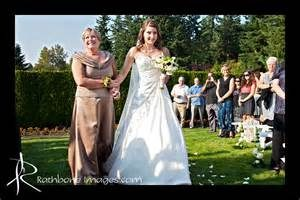 mom giving away the bride